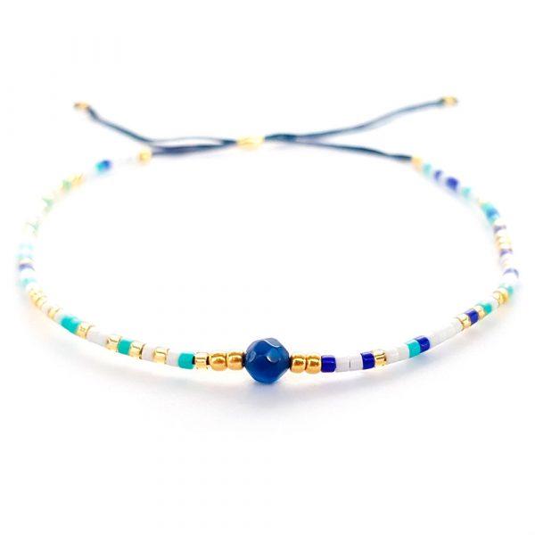 feines rocailles armband in blau und gold