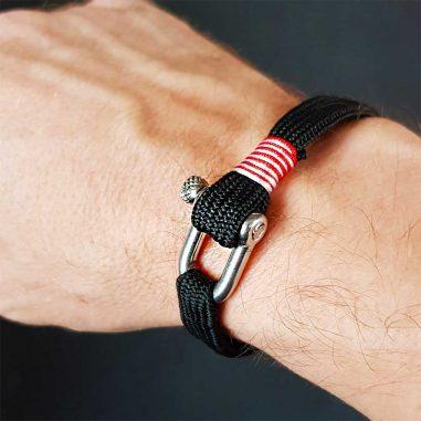 schaekel armband schwarz hand